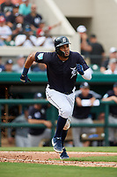 Detroit Tigers third baseman Jeimer Candelario (46) runs to first base during a Grapefruit League Spring Training game against the New York Yankees on February 27, 2019 at Publix Field at Joker Marchant Stadium in Lakeland, Florida.  Yankees defeated the Tigers 10-4 as the game was called after the sixth inning due to rain.  (Mike Janes/Four Seam Images)