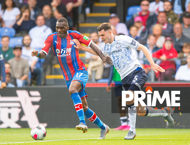 Crystal Palace Christian Benteke and Everton Michael Keane  during the Premier League match between Crystal Palace and Everton at Selhurst Park, London, England on 10 August 2019. Photo by Andrew Aleksiejczuk / PRiME Media Images.