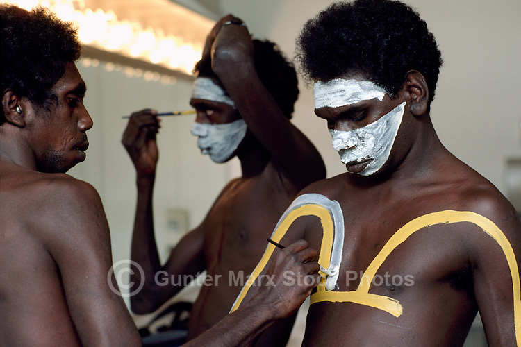 Aboriginal Australians / Australian Aborigines painting Faces and Bodies Backstage in preparation for Dancing Stage Performance (No Model Release Available)