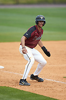 Justin Bowers (19) of the North Carolina Central Eagles takes his lead off of third base against the North Carolina A&T Aggies at Durham Athletic Park on April 10, 2021 in Durham, North Carolina. (Brian Westerholt/Four Seam Images)