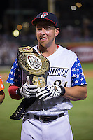 Chris Marrero of the Pawtucket Red Sox poses with the championship belt after winning the 29th Annual Triple-A Home Run Derby at BB&T BallPark on July 11, 2016 in Charlotte, North Carolina.  Marrero defeated Kyle Jensen (not pictured) of the Reno Aces 18-17.  (Brian Westerholt/Four Seam Images)
