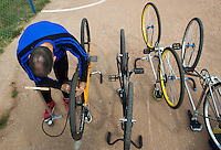13 SEP 2014 - IPSWICH, GBR - Stuart Gedge of Kesgrave Panthers checks the tyre pressures on his bike before the start of the 2014 British Open Club Cycle Speedway Championships at Whitton, Ipswich in Great Britain (PHOTO COPYRIGHT © 2014 NIGEL FARROW, ALL RIGHTS RESERVED)