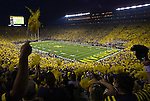 First half action kicks off in an NCAA college football game between Michigan and Notre Dame, Saturday, Sept. 10, 2011, in Ann Arbor, Mich.  This is the first ever night game to be played at Michigan Stadium. (AP Photo/Tony Ding)