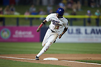 DJ Gladney (8) of the Kannapolis Cannon Ballers rounds third base during the game against the Columbia Fireflies at Atrium Health Ballpark on May 21, 2021 in Kannapolis, North Carolina. (Brian Westerholt/Four Seam Images)