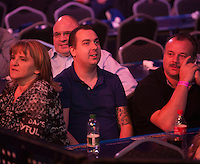 20.12.2014.  London, England.  William Hill World Darts Championship.  Kim Huybrechts (18) [BEL] watches his brother Ronny Huybrechts' [BEL] first round match against Andy Smith (28) [ENG].