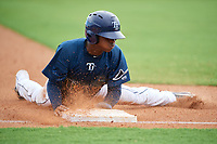 GCL Rays Johan Lopez (44) slides into third base during a Gulf Coast League game against the GCL Pirates on August 7, 2019 at Charlotte Sports Park in Port Charlotte, Florida.  GCL Rays defeated the GCL Pirates 5-3 in the second game of a doubleheader.  (Mike Janes/Four Seam Images)