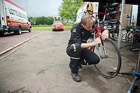 mechanic Frederik Moons (BEL) getting the bikes prepped for the much anticipated 'Roubaix-stage' the next day<br /> <br /> 2014 Tour de France<br /> stage 4: Le Touquet-Paris-Plage/Lille Métropole (163km)