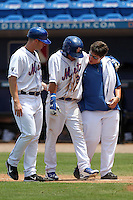 St. Lucie Mets shortstop Wilfredo Tovar #2 is helped off the field by the teams trainer as manager Ryan Ellis looks on during a game against the Jupiter Hammerheads at Digital Domain Park on May 2, 2012 in Port St. Lucie, Florida.  St. Lucie defeated Jupiter 3-2.  (Mike Janes/Four Seam Images)