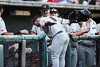 Trey Hair (6) of the Hickory Crawdads is splashed with water by his teammates after hitting  home run against the Winston-Salem Dash at Truist Stadium on July 10, 2021 in Winston-Salem, North Carolina. (Brian Westerholt/Four Seam Images)