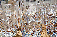 Display of antique glassware on sale at an antique shop.