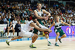 Basketball Real Madrid´s Bourousis (L) and Zalgiris Kaunas´s Javtokas and Lekavicius during Euroleague basketball match in Madrid, Spain. October 17, 2014. (ALTERPHOTOS/Victor Blanco)