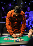 Yunus Jamal collects his chips after doubling up when an ace hit on the river.