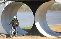 Dustin Luo, 6, rides Friday, April 2, 2021, rides through one of the tunnel obstacles at Fort Smith's Riverfront Skate and Bike Park. Dustin was riding with his brother at the park that also includes a bicycle playground for younger riders. Check out nwaonline.com/210403Daily/ and nwadg.com/photos for a photo gallery.<br /> (NWA Democrat-Gazette/David Gottschalk)