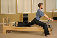 Pilates instructor Donal Kavanaugh on Reformer apparatus