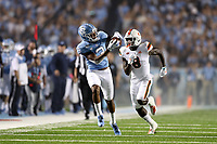 CHAPEL HILL, NC - SEPTEMBER 07: Antoine Greene #3 of the University of North Carolina caches a ball while being chased by DJ Ivey #8 of the University of Miami during a game between University of Miami and University of North Carolina at Kenan Memorial Stadium on September 07, 2019 in Chapel Hill, North Carolina.