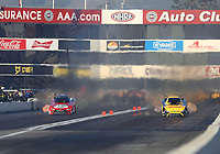 Feb 7, 2020; Pomona, CA, USA; NHRA funny car driver Alexis DeJoria (left) races alongside J.R. Todd during qualifying for the Winternationals at Auto Club Raceway at Pomona. Mandatory Credit: Mark J. Rebilas-USA TODAY Sports