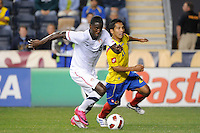 Eddie Johnson (9) of the United States (USA) is trailed by John Javier Restrepo (21) of Colombia (COL). The men's national teams of the United States (USA) and Colombia (COL) played to a 0-0 tie during an international friendly at PPL Park in Chester, PA, on October 12, 2010.