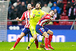 Atletico de Madrid's Diego Godin (l) and Lucas Hernandez (r) and Getafe CF's Jorge Molina during La Liga match. January 6,2018. (ALTERPHOTOS/Acero)