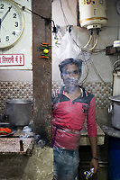 The dishwasher poses for a portrait at Jain Snacks Corner, a small cafe along Chadni Chowk Road, in Delhi, India, on Tue., Dec. 11, 2018.