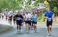 09 SEP 2011 - CHESTER, GBR - Competitors run up the hill into Farndon during the MBNA Chester Marathon .(PHOTO (C) NIGEL FARROW)