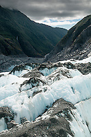 Looking across blue crevasses towards Waiho valley from Defiance Icefall of Franz Josef Glacier, Westland National Park, West Coast, World Heritage, South Island, New Zealand