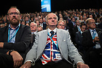 © Joel Goodman - 07973 332324 . 02/10/2017. Manchester, UK. A delegate listens to Chancellor Philip Hammond 's keynote speech during the second day of the Conservative Party Conference at the Manchester Central Convention Centre . Photo credit : Joel Goodman