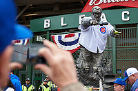 Fan takes a photo of the Chicago Cubs Harry Caray statue before Game 5 of the Major League Baseball World Series against the Cleveland Indians on October 30, 2016 at Wrigley Field in Chicago, Illinois.  (Mike Janes/Four Seam Images)