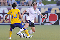 Heather O'Reilly, Therese Sjogran #15...USWNT tied Sweden 1-1 at Morrison Stadium, Omaha Nebraska.