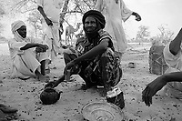 Sinet, Eastern Tchad, June 18, 2004.A well armed Zaghawa militia is protecting big herds of cattle grazing in the area from the repeated incursions of the Djanjavid militia across the border from Sudan. Afternoon teatime.