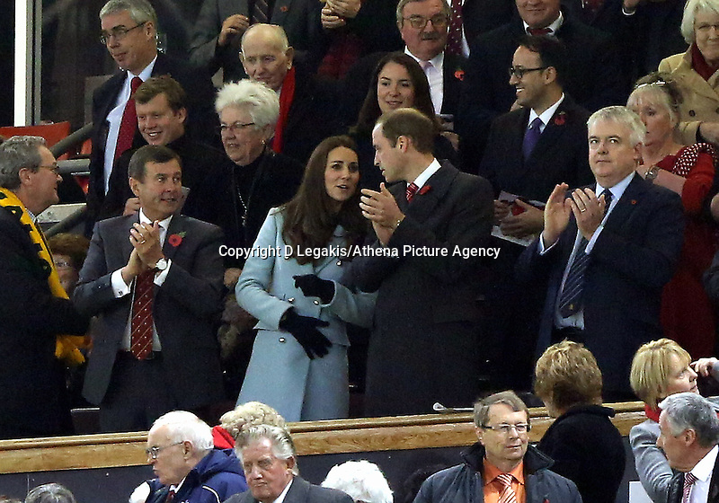 Pictured L-R: WRU chief executive Roger Lewis, Princess Kate, Prince William and First Minister for Wales Carwyn Jones applaud after the final whistle. Saturday 08 November 2014<br /> Re: Dove Men Series rugby, Wales v Australia at the Millennium Stadium, Cardiff, south Wales, UK.