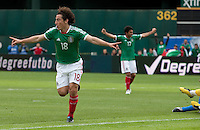 Andres Guardado (18) celebrates his goal ahead of Antonio Naelson Sinha (17). Mexico defeated Paraguay 3-1 at the Oakland Coliseum in Oakland, California on March 26th, 2011.