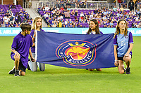 Orlando, FL - Saturday March 24, 2018: Flag kids display the Utah Royals FC flag prior to a regular season National Women's Soccer League (NWSL) match between the Orlando Pride and the Utah Royals FC at Orlando City Stadium. The game ended in a 1-1 draw.