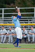 Burlington Royals first baseman Brandon Dulin (31) catches a pop fly in foul territory during the game against the Pulaski Yankees at Burlington Athletic Park on August 6, 2015 in Burlington, North Carolina.  The Royals defeated the Yankees 1-0. (Brian Westerholt/Four Seam Images)