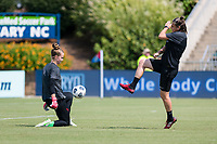CARY, NC - SEPTEMBER 12: Bella Bixby #31 of the Portland Thorns warms up with Portland Thorns goalkeeping coach Nadine Angerer before a game between Portland Thorns FC and North Carolina Courage at WakeMed Soccer Park on September 12, 2021 in Cary, North Carolina.