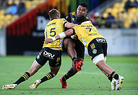 Chiefs Samisoni Taukei'aho is hit hard by Hurricanes Jordie Barrett & Du'Plessis Kirifi. Super Rugby Aotearoa. Hurricanes v Chiefs. Sky Stadium, Wellington. Saturday 20th March 2021. Copyright photo: Grant Down / www.photosport.nz