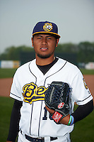 Burlington Bees pitcher Jaime Barria (18) poses for a photo before a game against the Bowling Green Hot Rods on May 7, 2016 at Community Field in Burlington, Iowa.  Bowling Green defeated Burlington 11-1.  (Mike Janes/Four Seam Images)