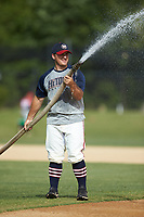 High Point-Thomasville HiToms hitting coach Jacob Schubert waters the infield prior to the game against the Deep River Muddogs at Finch Field on June 27, 2020 in Thomasville, NC.  The HiToms defeated the Muddogs 11-2. (Brian Westerholt/Four Seam Images)