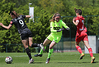 Goalkeeper Lise Musique (1) of Standard tries to kick the ball away before Hannah Eurlings (9) of OHL can have an attempt on goal  during a female soccer game between Standard Femina de Liege and Oud Heverlee Leuven on the 10th and last matchday in play off 1 of the 2020 - 2021 season of Belgian Scooore Womens Super League , saturday 29 th of May 2021  in Angleur , Belgium . PHOTO SPORTPIX.BE   SPP   SEVIL OKTEM