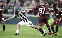 Calcio, Serie A: Torino, Allianz Stadium, 23 settembre 2017. <br /> Juventus' Paulo Dybala (l) in action with Torino's Evamgelista Lyanco (c) and Nicolas N'Koulou during the Italian Serie A football match between Juventus and Tori0i at Torino's Allianz Stadium, September 23, 2017.<br /> UPDATE IMAGES PRESS/Isabella Bonotto