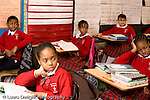 K-8 Parochial School Bronx New York Grade 4 male and female students seated in rows listening in class horizontal
