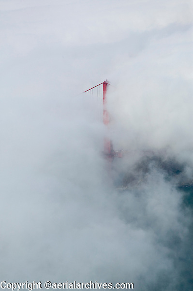 aerial photograph of the Golden Gate bridge shrouded in fog, San Francisco, California