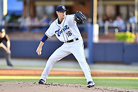 Asheville Tourists starting pitcher Garrett Schilling (18) delivers a pitch during a game against the Greensboro Grasshoppers at McCormick Field on May 10, 2018 in Asheville, North Carolina. The Tourists defeated the Grasshoppers 14-10. (Tony Farlow/Four Seam Images)