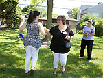 """Neighbors dance to """"It's a Wonderful World"""" during the Family Peace Fest for Hope and Harmony, in Morton Grove, Saturday, August 19, 2017. [Photo by Karen Kring]"""