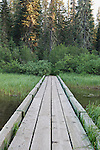 A wooden foot bridge crosses a stream entering Lake Takhlakh, Gifford Pinchot National Forest, Cascade Mountains, Washington State, USA near  Mt. Adams, located just 31 miles east of Mt. St. Helens. Represented exclusively at www.spacesimages.com