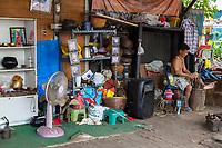 Bangkok, Thailand.  Craftsman at Work in his Shop.