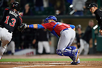 Toronto Blue Jays catcher Luke Maile (52), on rehab assignment with the Buffalo Bisons, tags Matt Hague (13) out at home while attempting to score the game winning run in the bottom of the ninth inning during a game against the Rochester Red Wings on August 25, 2017 at Frontier Field in Rochester, New York.  Buffalo defeated Rochester 2-1 in eleven innings.  (Mike Janes/Four Seam Images)