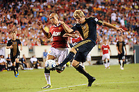 Toni Stahl (12) of the Philadelphia Union  clears the ball away from Gabriel Obertan (26) of Manchester United. Manchester United (EPL) defeated the Philadelphia Union (MLS) 1-0 during an international friendly at Lincoln Financial Field in Philadelphia, PA, on July 21, 2010.