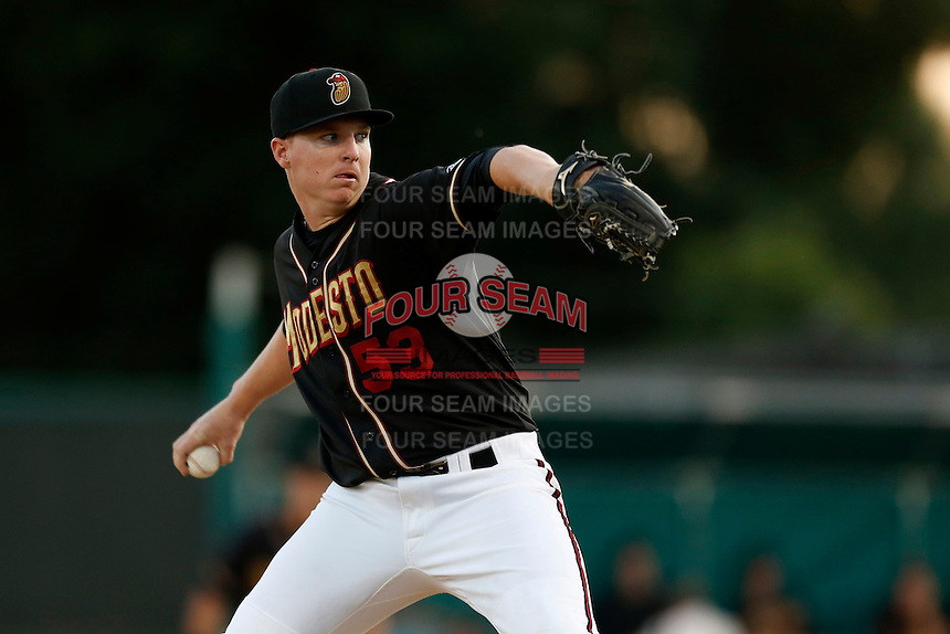 Jonathan Gray #53 of the Modesto Nuts pitches against the Lancaster JetHawks at John Thurman Field on August 8, 2013 in Modesto, California. Modesto defeated Lancaster, 6-2. (Larry Goren/Four Seam Images)
