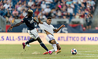 FOXBOROUGH, MA - JULY 27: Wilfried Zahibo #23 attempts to collect pass, Tesho Akindele #13 defends during a game between Orlando City SC and New England Revolution at Gillette Stadium on July 27, 2019 in Foxborough, Massachusetts.