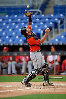 Miami Marlins catcher Nick Fortes (12) settles under a pop up during a Florida Instructional League game against the Washington Nationals on September 26, 2018 at the Marlins Park in Miami, Florida.  (Mike Janes/Four Seam Images)